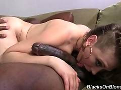 Sexy white whore gives black dude skilful blowjob.