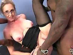 Lady boss is drilled by two black guys on office table.