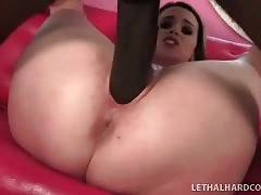 Pretty breasted babe hungrily slurps massive black dong.
