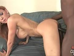 Breasted white lady is getting fucked by tough black dudes.