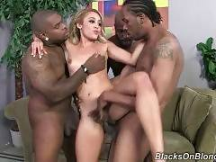 Petite blond cutie with hairy pussy gets deeply poked by black dude.