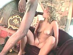 White blonde takes a black cock in her mouth and vagina