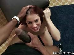Pretty white hooker slurps and rides massive black cocks.