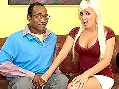 This busty blond is a rather sexy looking amateur - her tits are all natural but hot as fuck, and she also has the type of mouth that makes you think it's literally made for cocksucking. She works this big black dick with her hands and mouth, because ther
