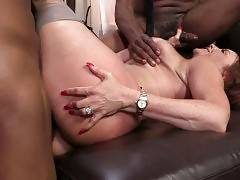 Sexy lady gladly welcomes massive black cocks inside her pussy.